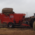 Brome bale just loaded into mixer